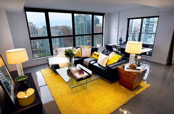 Black-couch-adds-visual-punch-to-the-living-room-in-yellow-and-grey