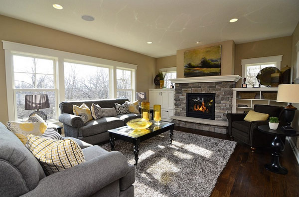 Gray-and-yellow-color-palette-lends-sophistication-to-this-contemporary-living-room-with-a-fireplace