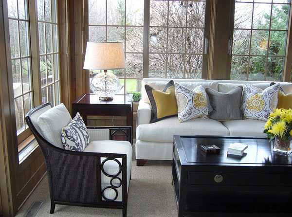 Use-throw-pillows-to-bring-in-the-gray-and-yellow-color-scheme