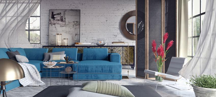 salone vintage, pareti con mattoncini bianchi a vista, bel divano blu vintage in tessuto.