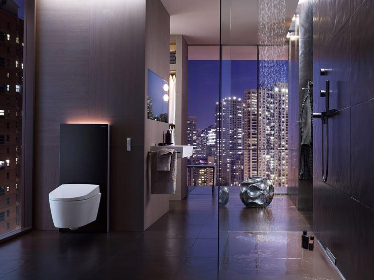bagno moderno con pareti nere, wc bianco con luci led, super tecnologico