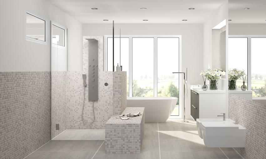 bagno con elementi in muratura, rivestimento piastrelle mosaico beige.