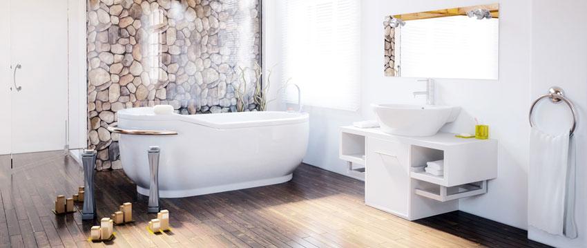 bagno dal design moderno tipo spa con parete con effetto sassi.
