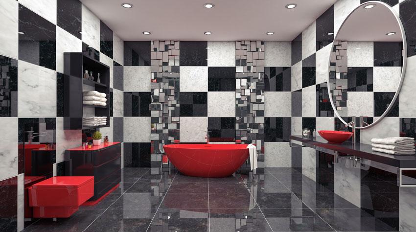 bagno design con piastrelle a quadri bianchi e neri, vasca da bagno rossa, sanitari rossi, lavandino rosso su mobile nero.
