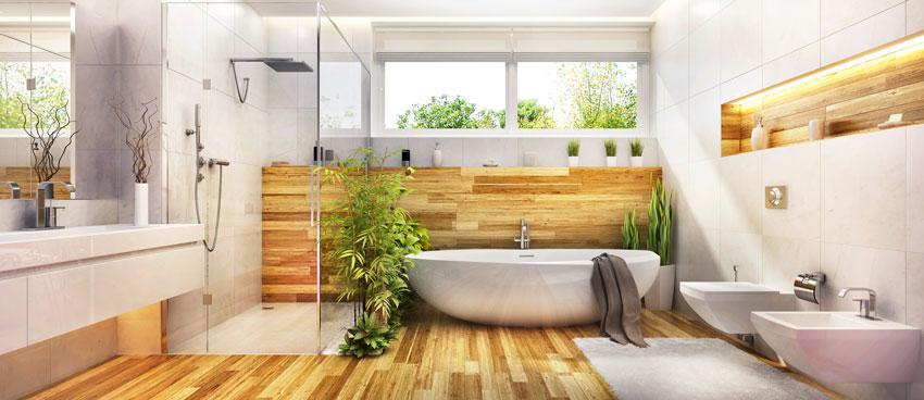 bagno con arredi moderni, vasca da bagno, box doccia e arredi a parete, bella decorazione con piante.