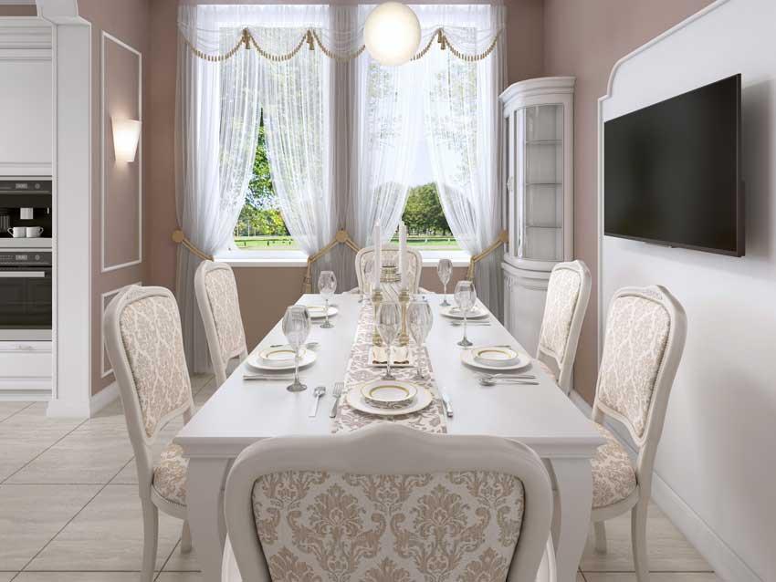 sala da pranzo country chic con tavolo bianco e sedie bellissime, pareti tortora e bianche.