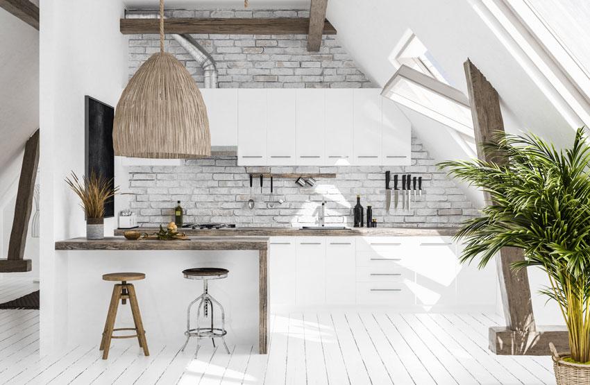 cucina design originale, misto pietra e legno, penisola in muratura con top in legno.