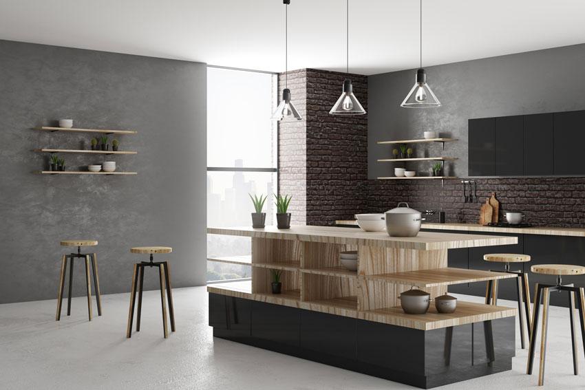 cucina dal mood moderno con isola nera e legno con spazio per ordinare piatti e pentole.