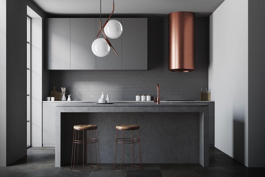 cucina grigia antracite dal design moderna con cappa in rame