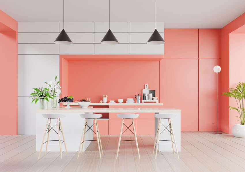 cucina moderna bellissima bianca e rosa, isola cucina bianca con lampade sospese di colore nero.