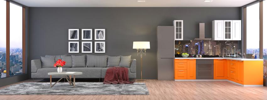 cucina open space moderna con mobili arancione e pareti grigie.