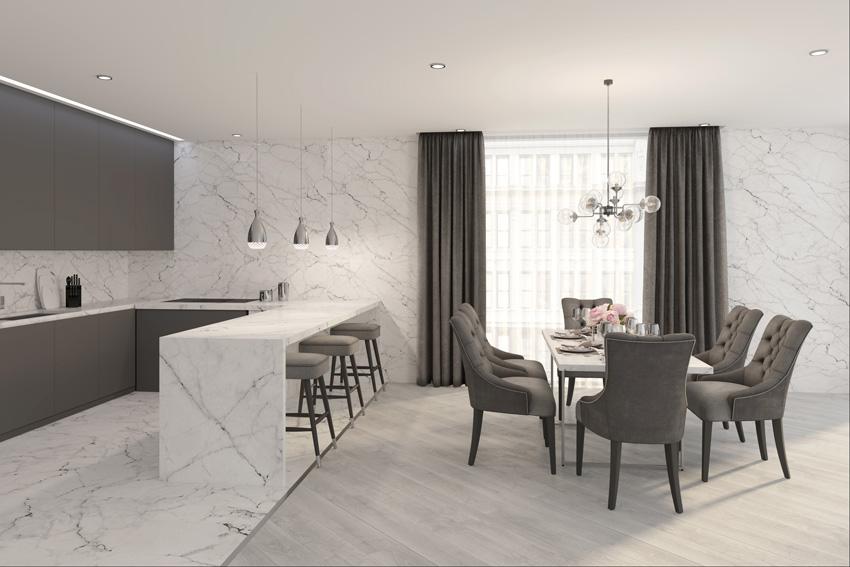 cucina open space con mobili grigi, penisola e pareti effetto marmo, belle tende e sedie grigie abbinati alla cuicna.