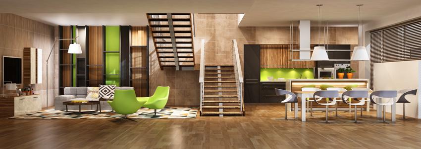 ambiente open space moderno, soggiorno e cucina separati da una grande scala centrale.