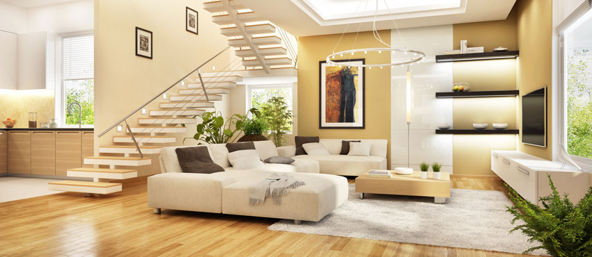 soggiorno con cucina a vista, scala centrale come divisorio, bellissimo divano ad u.