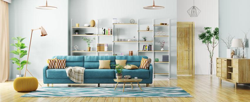 soggiorni moderni idee e ispirazioni: divano blu e pouf giallo.