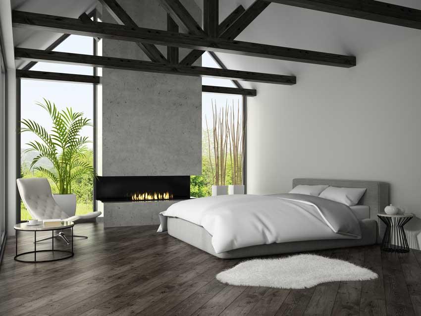 stanza da letto moderna con arredamento minimal e bel camino.
