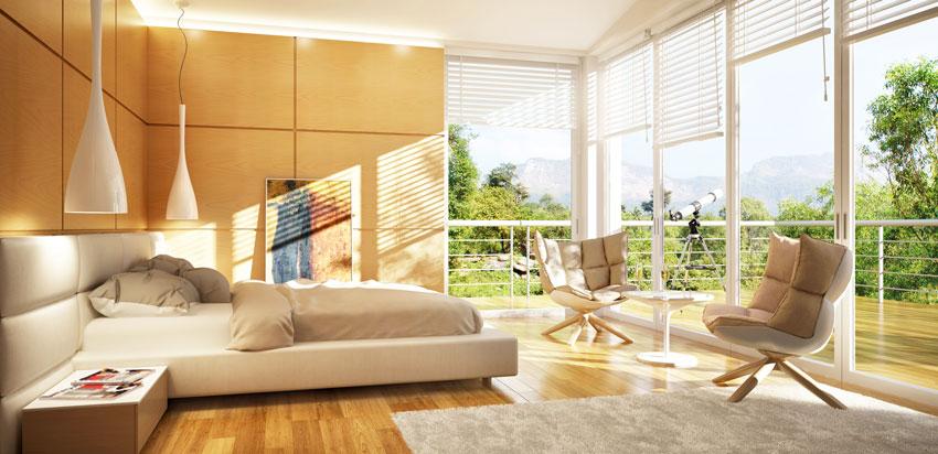 stanza da letto contemporanea con lampadari moderni sospesi design, testata letto in pelle beige.