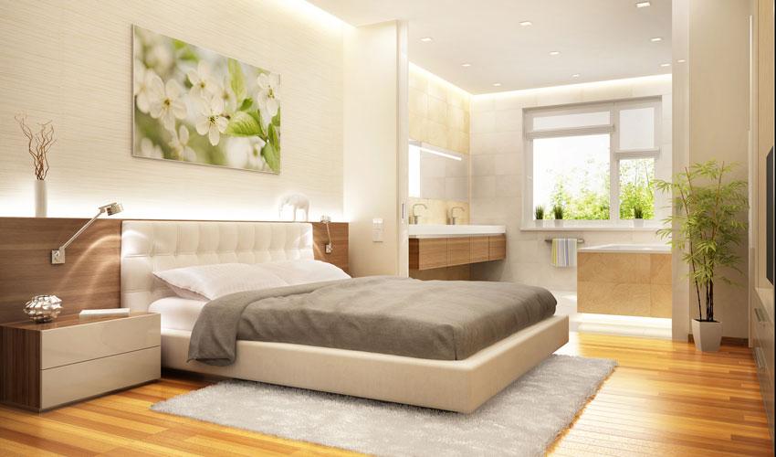 camera da letto con molta luce, colori beige, tortora e marrone.