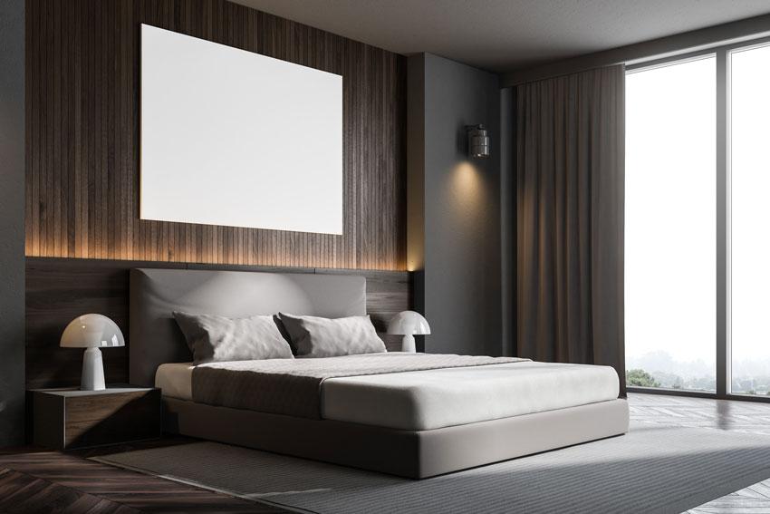 Stanze da letto moderne con illuminazione sopra testata letto.