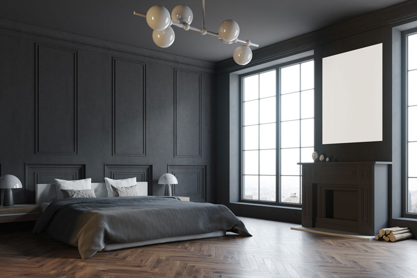 Camera da letto dal design moderno con pareti in boiserie di colore scuro.