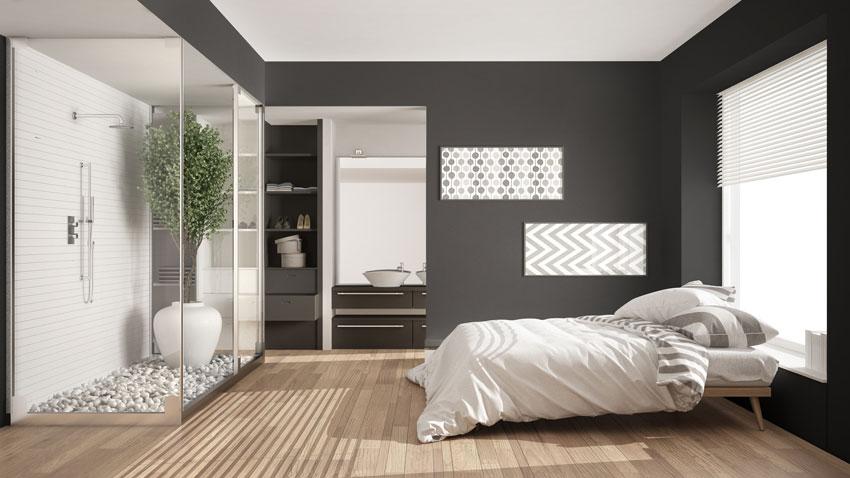 Box doccia con lastre in vetro, perfetto per camere da letto moderne.