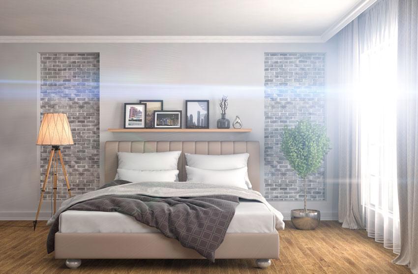 Una camera da letto dallo stile moderno con pareti in mattoncini.