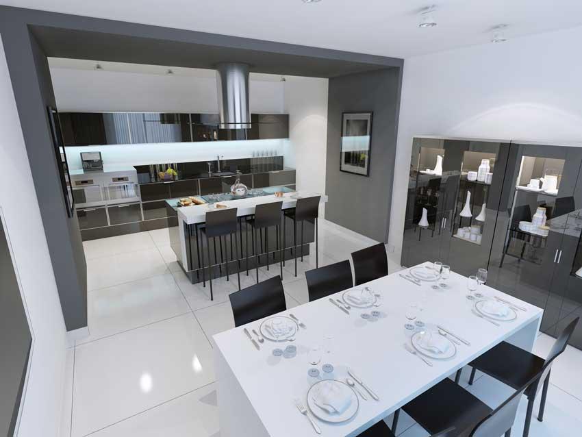 Cucina all'americana con isola centrale zona lunch, mobilio moderno lucido, credenza in vetro.