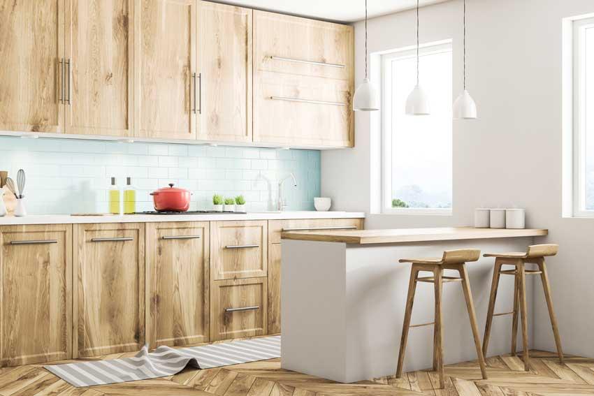 Le cucine con penisola in stile scandinavo sono semplicemente affascinante. Bellissimo il colore del legno.