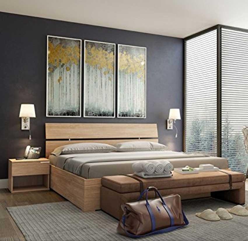 Camera con letto matrimoniale moderno.