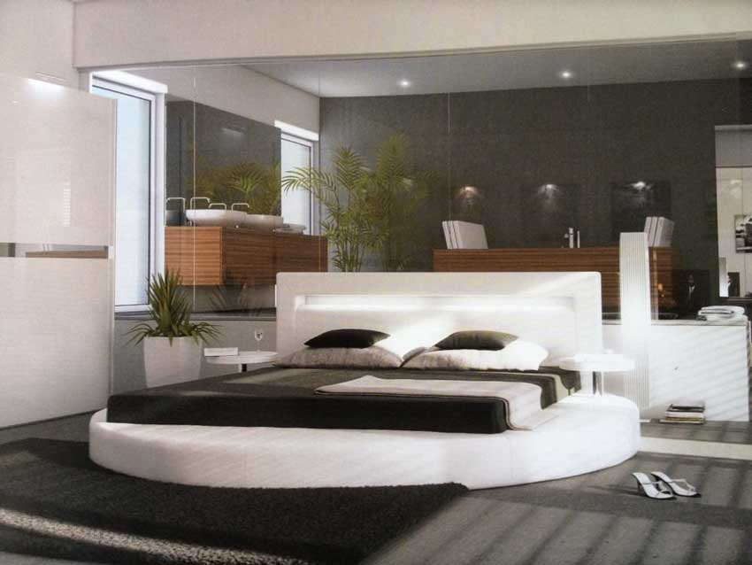 Camere da letto moderne con letto tondo e specchio grande.