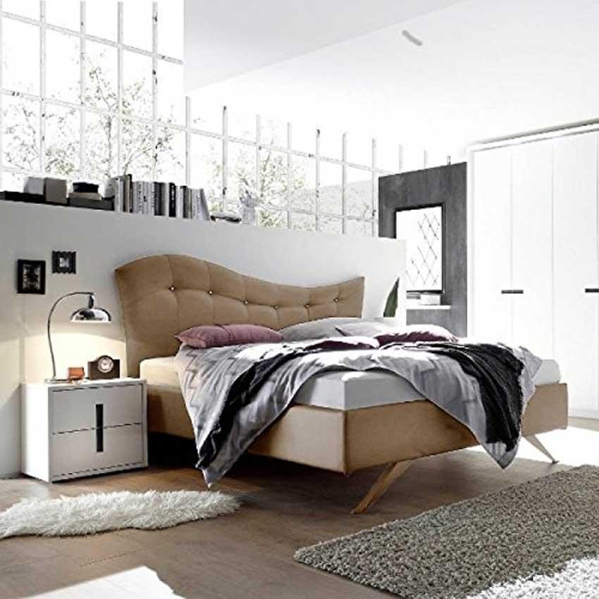 Camera da letto moderna con testiera beige design.