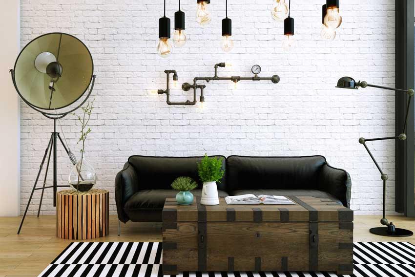Salotto con lampade realizzate con tubolari idraulici, arredamento stile vintage.
