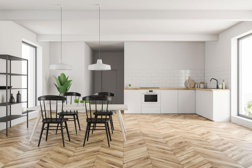 Esempio di una casa open space con cucina ad angolo e parquet.