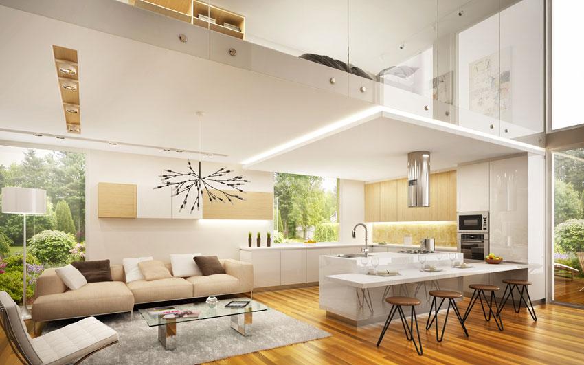 Cucina e soggiorno nello stesso ambiente con camera da letto a soppalco.