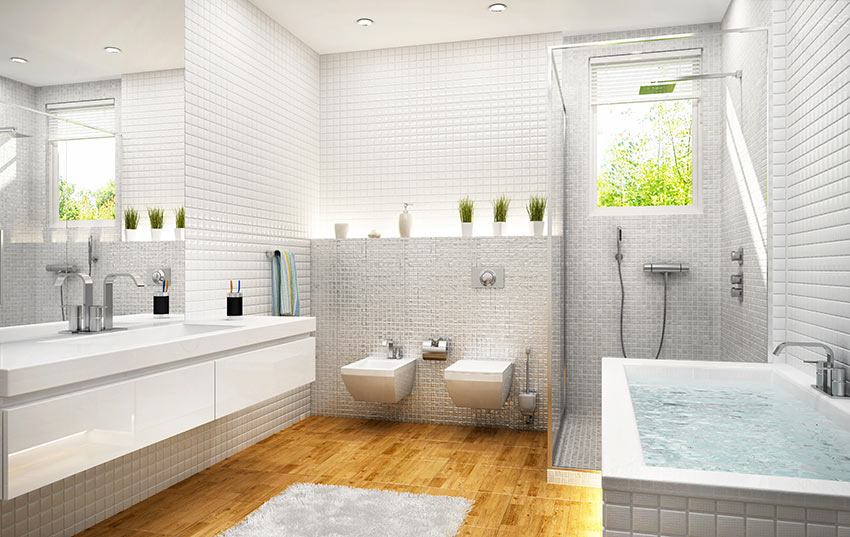 Bagni in muratura rivestiti con piastrelle effetto mosaico.