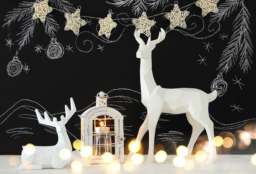 Renne di Natale bianche stilizzate.