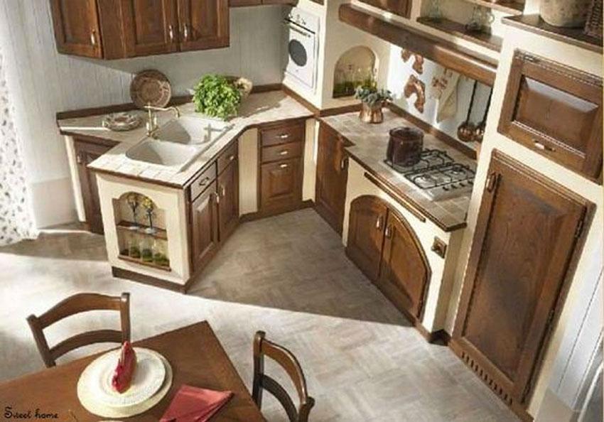 Cucina rustica in muratura con angolo piano lavabo particolare.