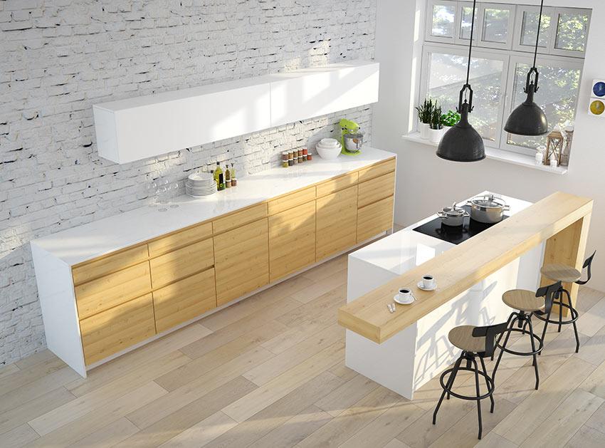 Cucina bianca e rovere, isola bianca con top design in legno, parete con mattoni a vista bianchi.