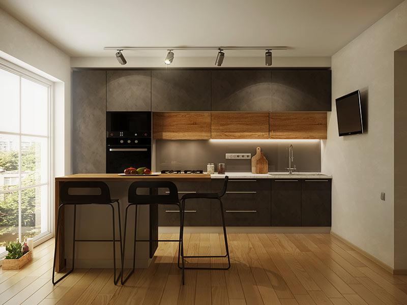 Casa moderna con cucina piccola nera opaca e top in legno, isola centrale con sgabelli.