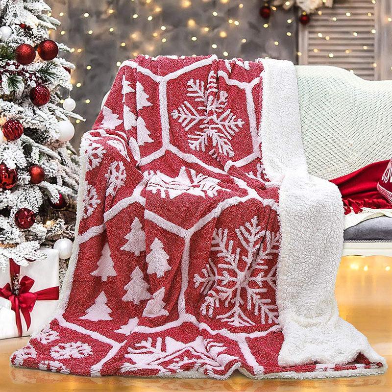 Bellissima calda coperta natalizia rossa e bianca per decorare il divano.