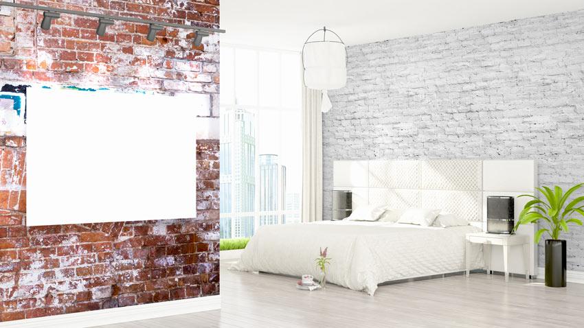 Camera da letto vintage con pareti di mattoni a vista.