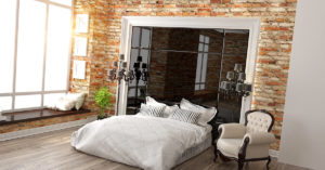 ispirazioni di camere da letto con pareti con mattoni a vista stile vintage.