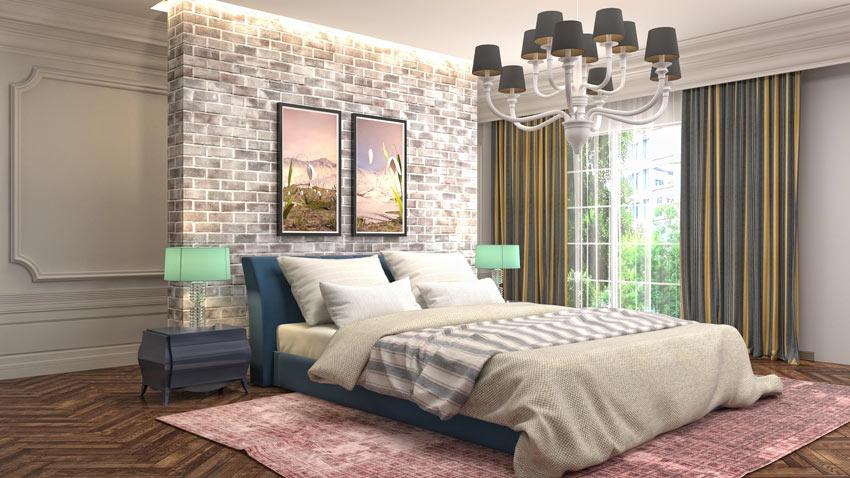 Parete dietro letto rivestita di mattoni vintage.