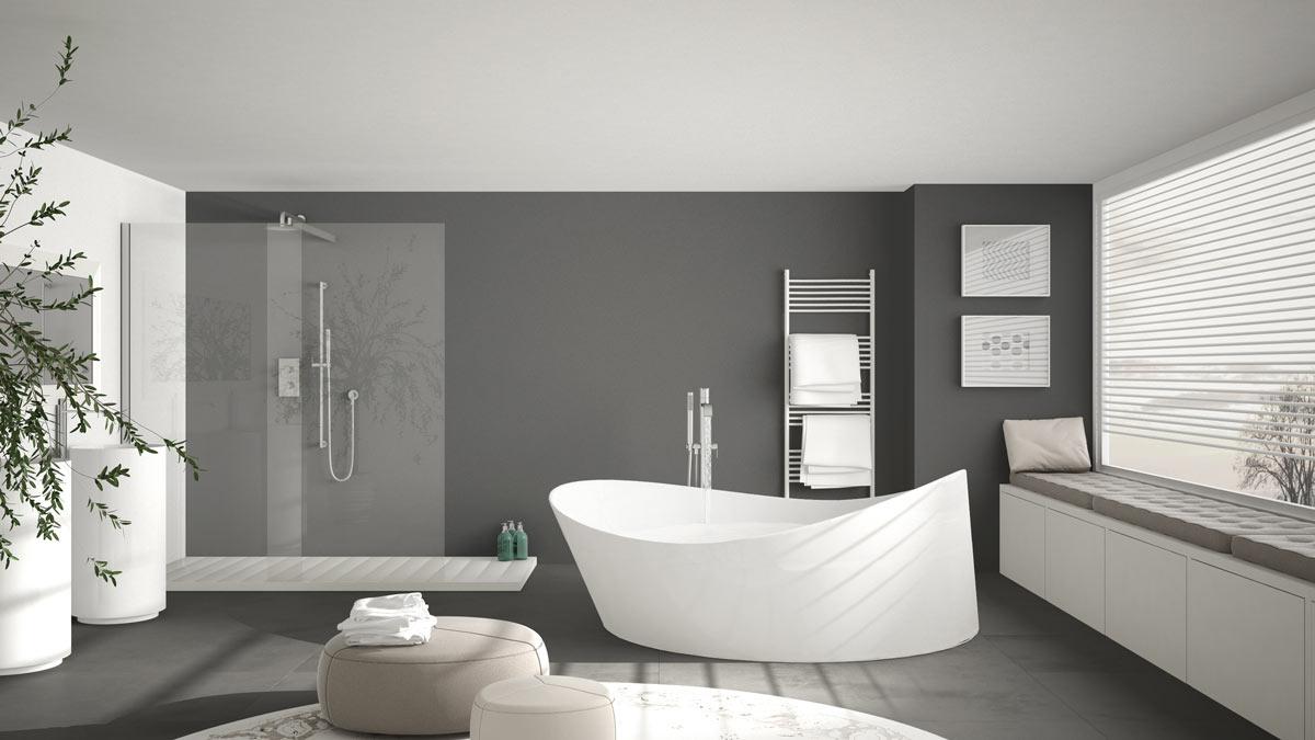 Bagno moderno grigio con vasca design bianca.