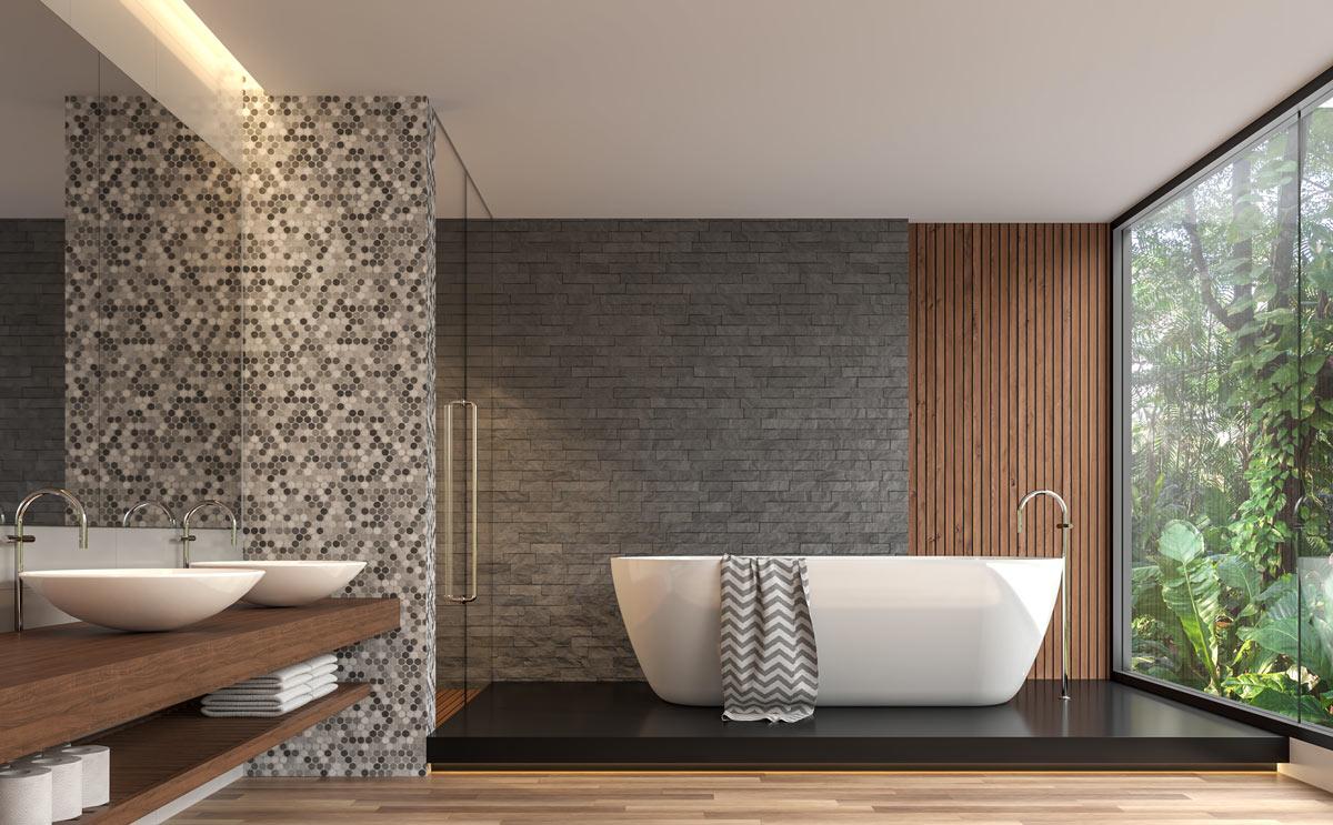 Un bagno moderno con diverse tonalità di grigi.