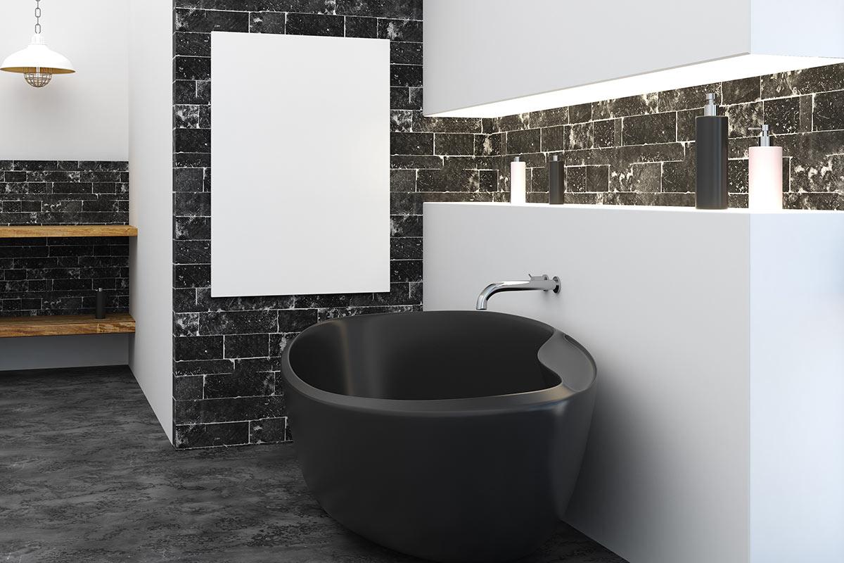 Bellissimo bagno in bianco e nero, vasca nera, pareti bianche con mattonelle grigie e mobile sospeso in legno.