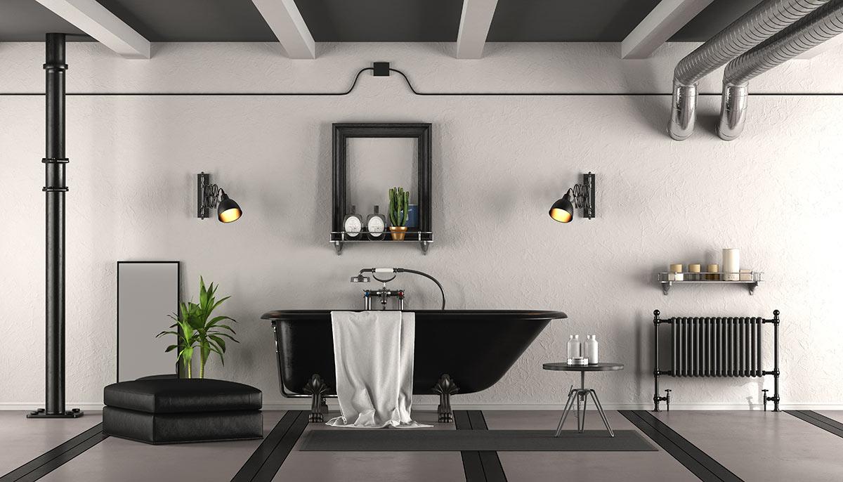 Bagno nero moderno con vasca nera e parete bianca.