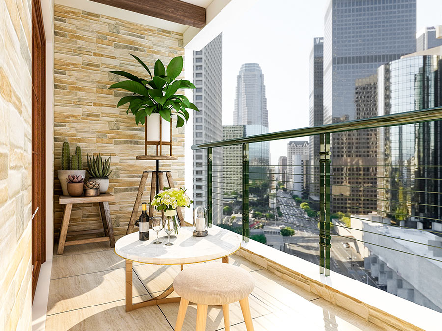 Bel balcone arredato con un tavolino e comodo sgabello.