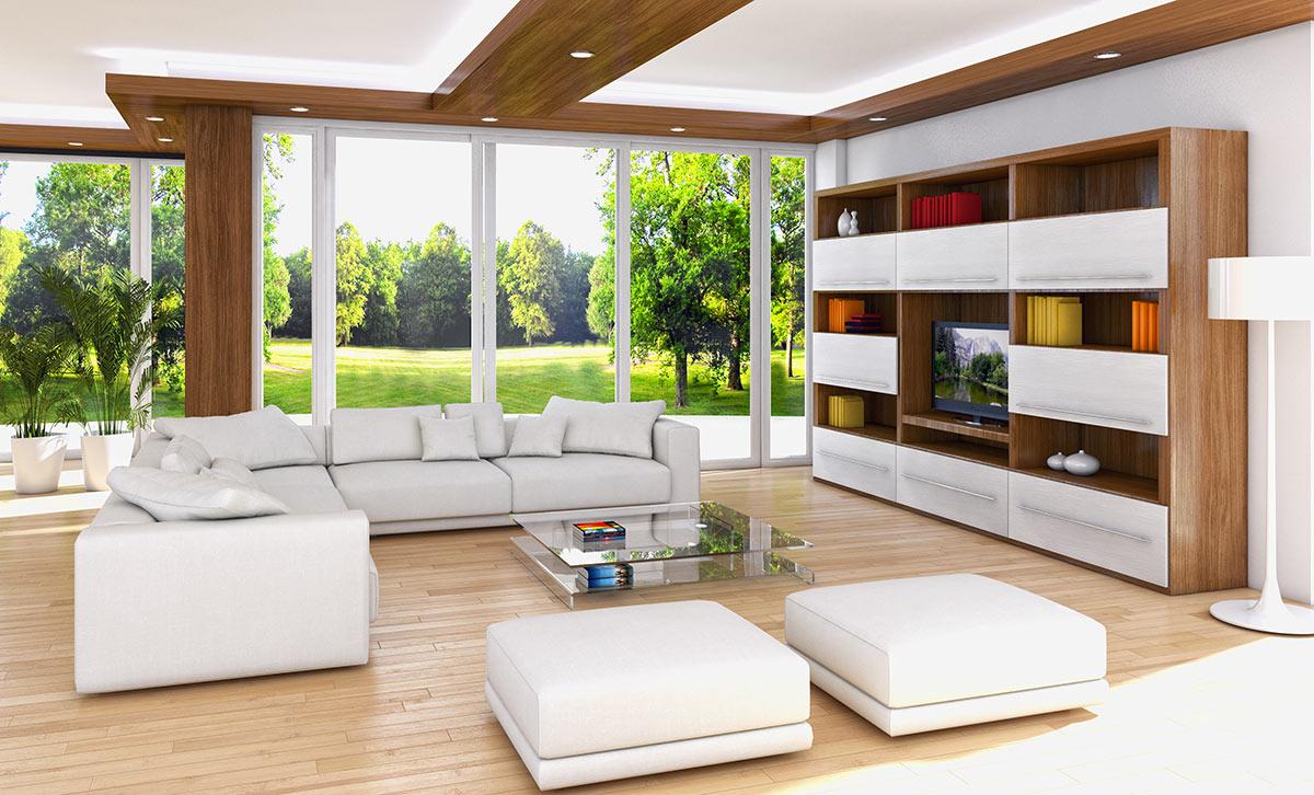 Grande salotto con divano ad angolo bianco e libreria a muro.