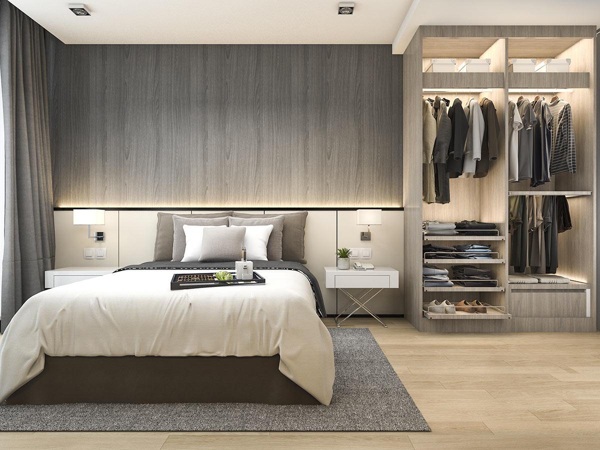 Camera da letto moderna con piccola armadio a muro.